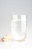 Pills and water Stock Images