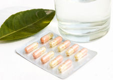 Pills and water cup Royalty Free Stock Photo