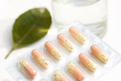 Pills and water cup Royalty Free Stock Image