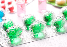 Pills with water droplets Royalty Free Stock Photography