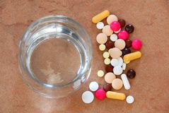 Pills and water glass Stock Photo