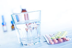 Pills and water Royalty Free Stock Image