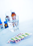 Pills and water Stock Photos