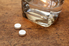 Pills and water Royalty Free Stock Photos