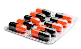 Pills on white. Pack of black-red pills on a white background Royalty Free Stock Photography