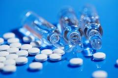 Pills. White medical pills on blue Stock Images