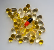 Pills on the white surface Royalty Free Stock Photography