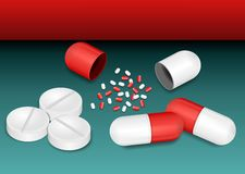 Pills. White tablets, red, and white capsules Royalty Free Stock Photography