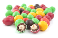 Pills With Peanuts Covered With Multicolored Glaze Stock Images