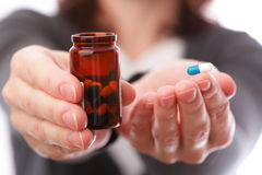 Pills in woman hand Royalty Free Stock Photos