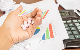 Pills on woman hand Royalty Free Stock Image