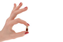 Pills in woman hand isolated royalty free stock photography