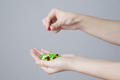 Pills in women hand Stock Photography