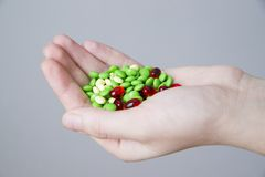 Pills in women hand Royalty Free Stock Images