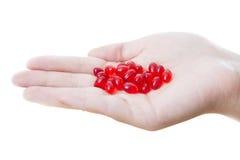Pills in women hand Stock Images
