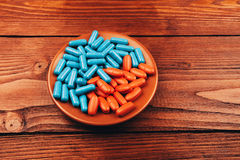 Pills on wooden table Royalty Free Stock Photography