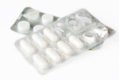 Pillules de médecines au-dessus de blanc Images libres de droits