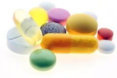 Pillules et vitamines Photographie stock