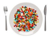 Pillules servies de repas sain photographie stock