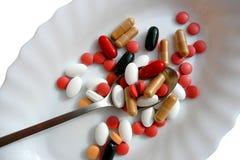 Pillules, tablettes ou vitamines Photographie stock libre de droits