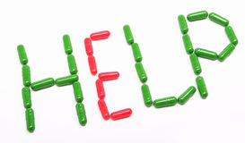 Pillules vertes de rouge d'annonce Image libre de droits