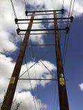 Pilone Ringwood Hampshire di elettricità del pericolo Fotografia Stock
