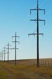 Pilones de la electricidad Imágenes de archivo libres de regalías