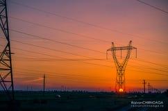 Pilones de la electricidad de la silueta Foto de archivo libre de regalías