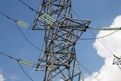 Pilones y línea de la electricidad Fotografía de archivo libre de regalías