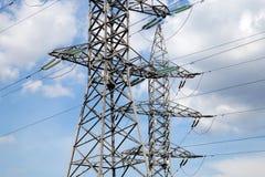 Pilones y línea de la electricidad Imágenes de archivo libres de regalías
