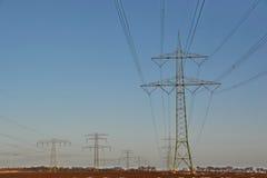 Piloni di elettricità Fotografie Stock