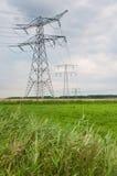 Piloni di potenza in una zona olandese rurale Fotografia Stock Libera da Diritti