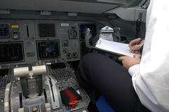 Pilot 2. Plane at the airport, checking before the trip Stock Image
