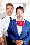Pilot and air hostess Royalty Free Stock Photography