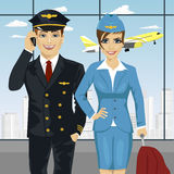 Pilot and air hostess in uniform at airport Stock Images