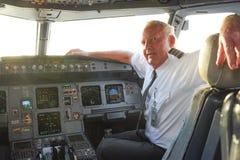 Pilot in aircraft cockpit Stock Photos