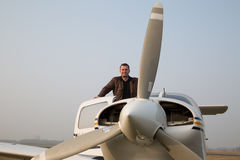 Pilot with the aircraft after landing stock photo