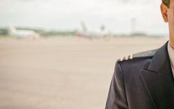 Pilot on the airfield. Royalty Free Stock Images