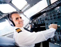 Pilot in an airplane cabin Stock Image