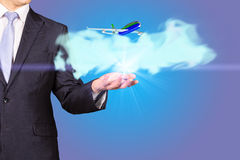 Pilot with airplane taking off from his hand Royalty Free Stock Photo