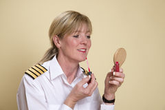 Pilot applying lip gloss Stock Photo