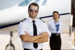Pilot With Arms Crossed Standing Against Royalty Free Stock Image