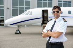 Pilot With Arms Crossed Standing In Front Of Royalty Free Stock Photo