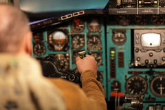 Pilot aviates aircraft Royalty Free Stock Image
