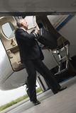 Pilot boarding a private airplane Royalty Free Stock Photo