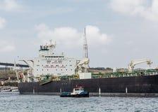 Pilot Boat Alongside Massive Tanker Royalty Free Stock Images
