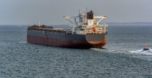 Free Pilot Boat And Bulk Carrier Cargo Ship Royalty Free Stock Image - 129162846