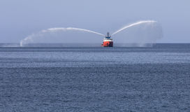 Pilot boat in bay spraying water Stock Images