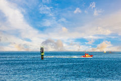 Pilot boat and buoy Stock Photography