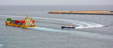 Pilot boat and container ship Royalty Free Stock Image